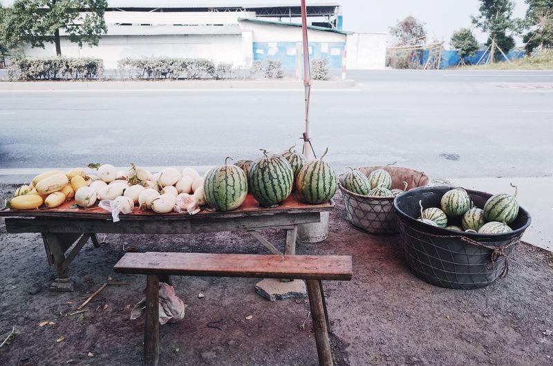 Fresh vegetables in basket for sale at market stall