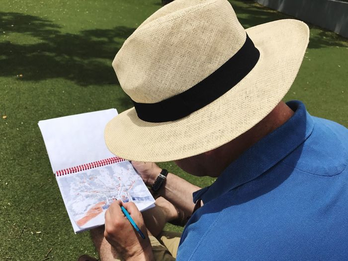 Hat Straw Hat Sun Hat Outdoors Leisure Activity Grass One Person Day Men Lifestyles Holding Nature Real People Golf One Man Only Golf Course Adult People