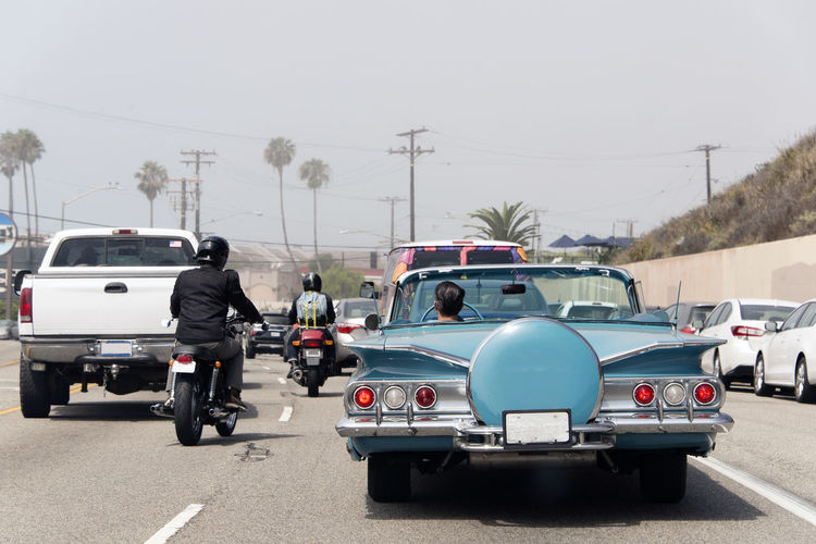 A traffic jam in Malibu, California with a vintage convertible car, motorcycle and pick up truck in summer time Mode Of Transportation Transportation Car Land Vehicle Motor Vehicle Road Street City Travel Day Real People Sky Traffic Men Vintage Car Motorcycle California Los Angeles, California Journey Insurance Traffic Jam Convertible Classic