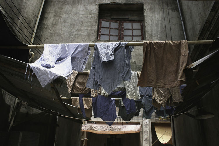 Low Angle View Of Clothes Drying Against The Window