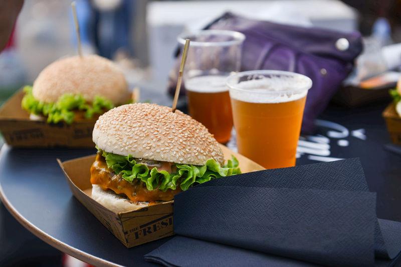 Close-up of beer and hamburgers