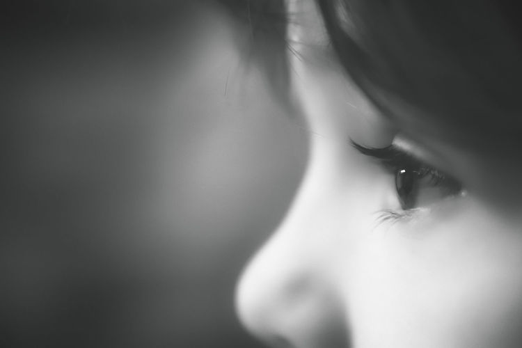Close-up Human Body Part One Person Human Face Body Part Portrait Contemplation Child Childhood Indoors  Looking Headshot Offspring Eye Human Eye Innocence Looking Away Black Background Profile View Black And White Black Background Black & White Black And White Portrait Monochrome Black And White Photography
