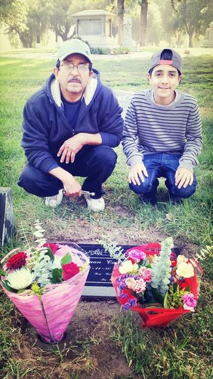 my dad and little brother Carlitos at my brother Juan Carlos grave