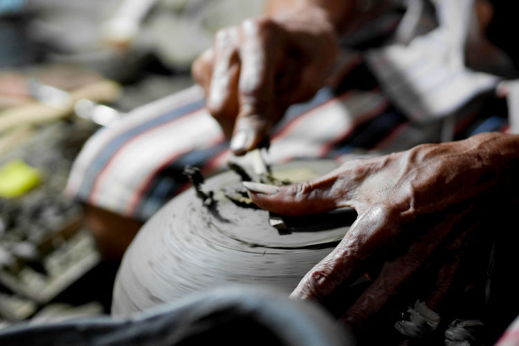 Cropped hand of man working in workshop