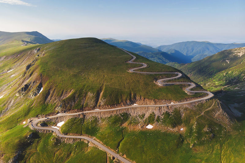Aerial view of Transalpina mountain road, Romania Aerial View Mountain Road Drone  Curves Winding Road Transalpina Road Romania Transfagaraşan Mountain Nature Landscape Cars Driving Green Forest Pine Tree