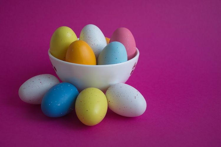 Egg Food Food And Drink Multi Colored Studio Shot Indoors  Still Life Easter Colored Background No People Easter Egg Holiday Celebration Pink Color Variation Close-up Choice Purple Purple Background Bowl White Yellow Blue Copy Space Multicolored