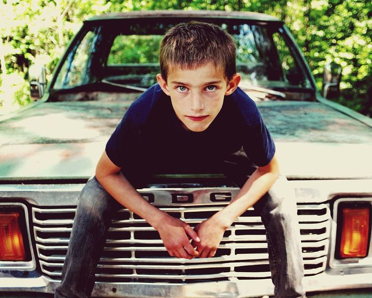 The Portraitist - 2016 EyeEm AwardsFace Close Up Portraiture Boy Youth Of Today Strong Confident  Confidence  Childhood Eyes Looking At Camera Old Truck Trouble Troublemaker Boys Will Be Boys Portrait Color Portrait Samsung Nx1 Pacific Northwest  Dodge Ready To Go Outdoors Stehekin