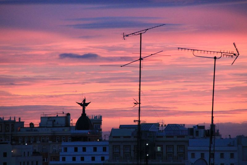 Enjoying Life Check This Out Taking Photos Hanging Out Antenna Antenna - Aerial Roof Rooftop City Rooftops  City Colorful Sky And Clouds Colorful Sky Sundown Sunset Sunset Sky Cloud - Sky Architecture Built Structure Orange Color Building Exterior Silhouette No People Dusk Outdoors Statue City Nature Day