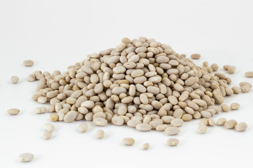 Heap of navy beans on white background. Shallow DOF. Agricolture Background Beans Close-up Diet Dried Dry Food Haricot Healthy Heap Ingredients Isolated Legume Navy Nutrition Organic Protein Raw Small Vegan Vegetable Vegetarian Vulgaris