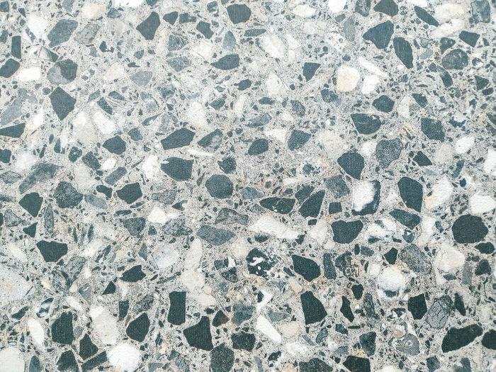 Full frame shot of water drops on tiled floor