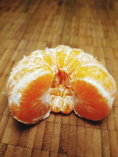 Close-up of orange slices on table