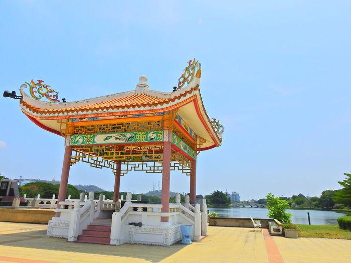 Thai architecture against clear blue sky