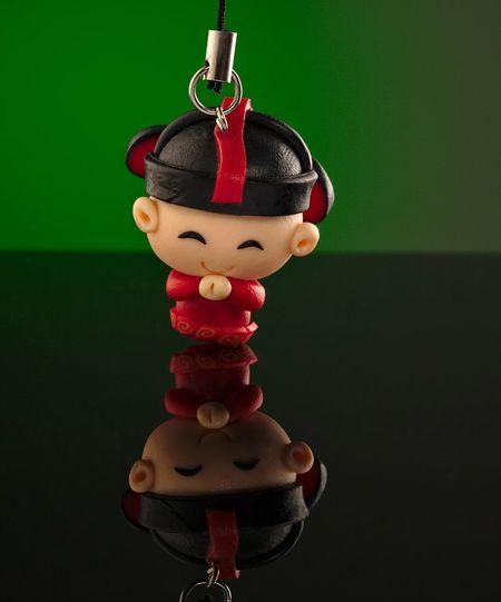 Chinese key chain holder of a Dizhu Figure Close-up Day Dizhu Hanging Indoors  Key Chain Holder Red Studio Shot 地主