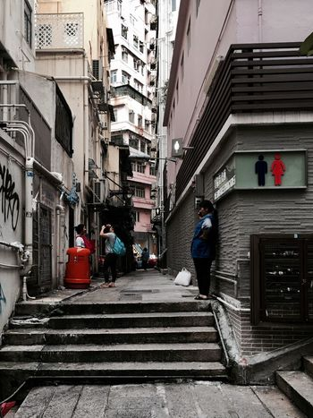 Building Exterior City Life Narrow Lane Architecture Narrow Cityscapes Hong Kong Street Hong Kong City Walking Around Light And Shadow IPhoneography City Life People And Places Old Buildings Street Photography People Watching Lifestyles Narrow Lane City Street Snap A Stranger