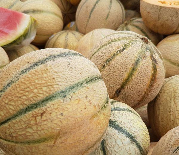 Full frame shot of cantaloupes at market stall