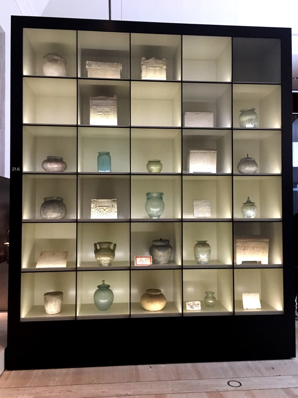 indoors, no people, large group of objects, illuminated, shelf, modern, choice, variation, container, retail, architecture, multi colored, wealth, in a row, glass - material, collection, transparent, arrangement, design, pattern, luxury
