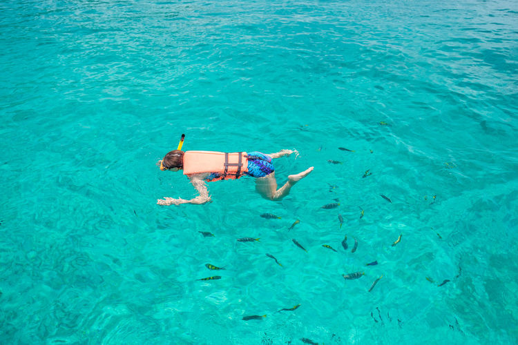 High angle view of woman snorkeling in turquoise sea
