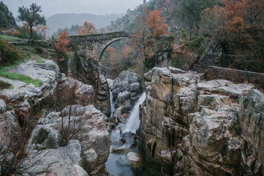National Park Peneda Geres An Eye For Travel Business Stories Castle EyeEmNewHere FUJIFILM X-T2 Kornspeicher Lindoso Misarela Bridge National Park Nature Peneda-Gerês National Park Ponte De Misarela Portugal Shades Of Winter Architecture Beauty In Nature Bridge Bridge - Man Made Structure Built Structure Connection Day Espigueiros Espigueiros Do Lindoso Explore Fujifilm Nature No People Outdoors River Rock - Object Tree Water