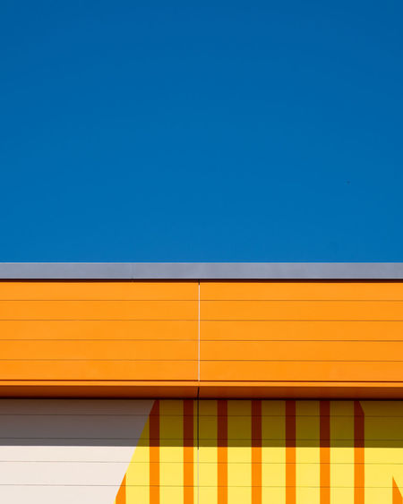 Orangeagain Architectural Detail Architectural Feature Architecture Berlinmalism Blue Building Exterior Built Structure Clear Sky Copy Space Fujix_berlin Fujixe3 Minimal Minimalism Minimalist Photography  Multi Colored No People Orange Color Pattern Ralfpollack_fotografie Sky Striped Wall - Building Feature Yellow