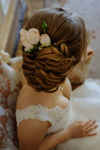 Adult Bride Brown Hair Flower Flowering Plant Focus On Foreground Hair Hairstyle Headshot High Angle View Indoors  Leisure Activity Life Events Lifestyles One Person Portrait Real People Rear View Wedding Hair Wedding Hairstyles Women Young Women