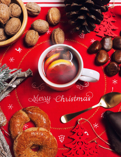 Cup of hot tea with lemon and cinnamon on the Christmas table. View from above. Christmas Marry Christmas Nuts Roccoco Tea Celebration Close-up Coffee - Drink Coffee Cup Cookie Day Directly Above Drink Food Food And Drink Freshness Healthy Eating High Angle View Indoors  Mostaccioli One Person People Red Refreshment Table