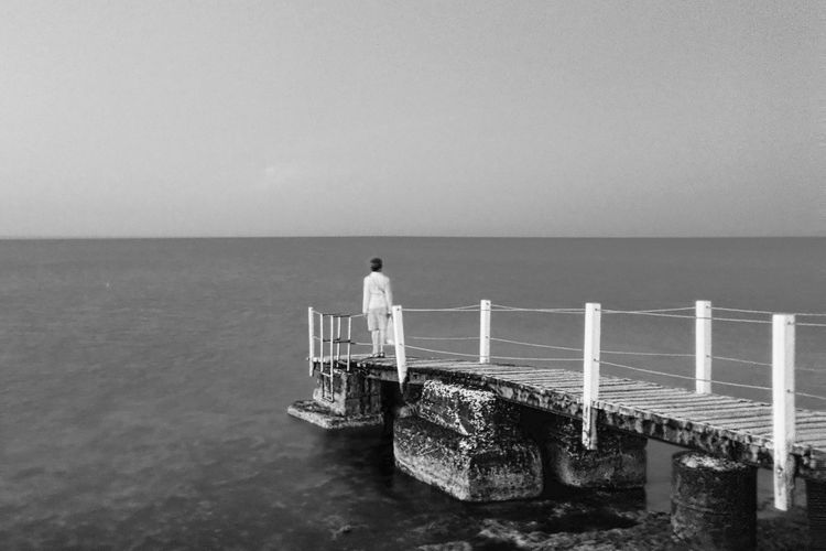 Sea Water Horizon Over Water Real People Clear Sky Nature Scenics Railing Copy Space Standing Sky Outdoors Tranquil Scene Idyllic Beauty In Nature Tranquility One Person Rear Protaras Cyprus Blackandwhite Monochrome Bnw Live For The Story The Great Outdoors - 2017 EyeEm Awards