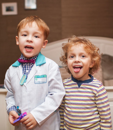Boy Caucasian Child Children Doctor  Health Hospital Kid Patient Pediatrics Play Playful Tongue Two Vertical