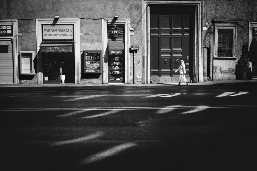 Moving Around Rome Rome Stories From The City Walking Around Architecture Black And White Building Exterior Built Structure Door Light And Shadow Real People Road Street Streetphotography