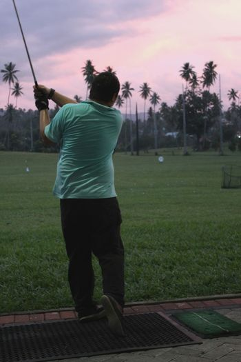 Old pic. Brother , Golf , Hit , Grass , Purple , Sky, Field, Sport
