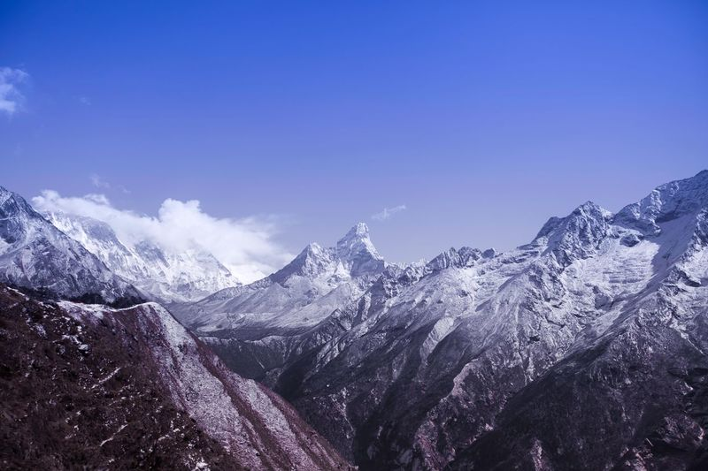 """https://youtu.be/lpLd8K-NYuA from left to right: Mt. Everest (8850m) """"Sagarmatha"""", Lhotse (8516m) """"South Peak"""" and Ama Dablam (6814m) """"Mother and her necklace"""" Sky Mountain Beauty In Nature Snow Scenics - Nature Cold Temperature Stay Out My Best Photo My Best Photo The Great Outdoors - 2019 EyeEm Awards"""