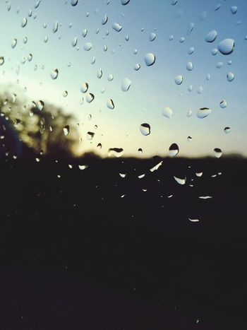 Raindrops on my window, with a Sunrise in the background. Light And Shadow giving a nice feel, slong with the Blurry background