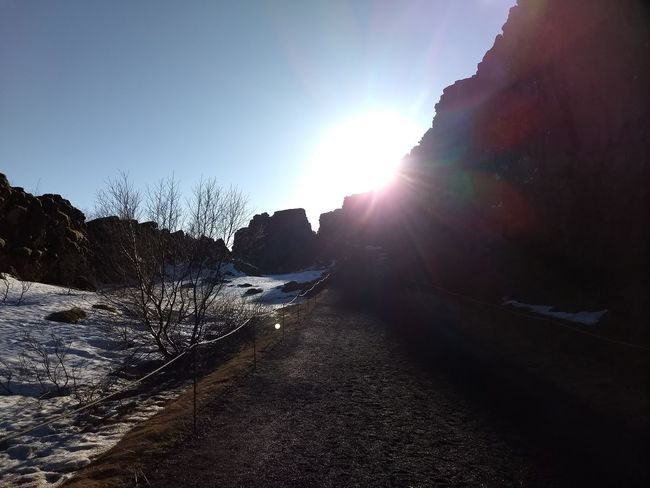 long road Silhouette Sunlight Sky Shining Sunbeam Calm Rock Formation Rocky Mountains Natural Arch Geology Physical Geography Lens Flare Sun