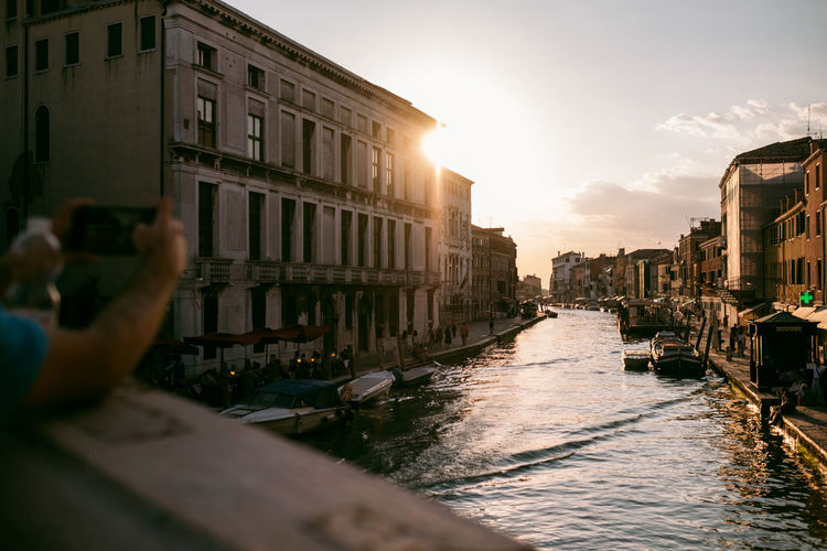Venice Building Exterior Water Built Structure Architecture Nautical Vessel Transportation Sky Canal Nature Mode Of Transportation Building City Real People Sunset One Person Sunlight Photography Themes Photographing Activity Sun Outdoors