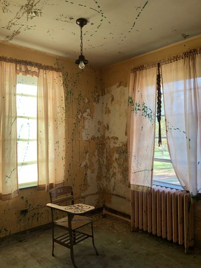 Abandoned Indoors  Window Seat Architecture Table No People Chair Curtain Absence Building Home Interior Empty Furniture Sunlight Flooring Ceiling Built Structure