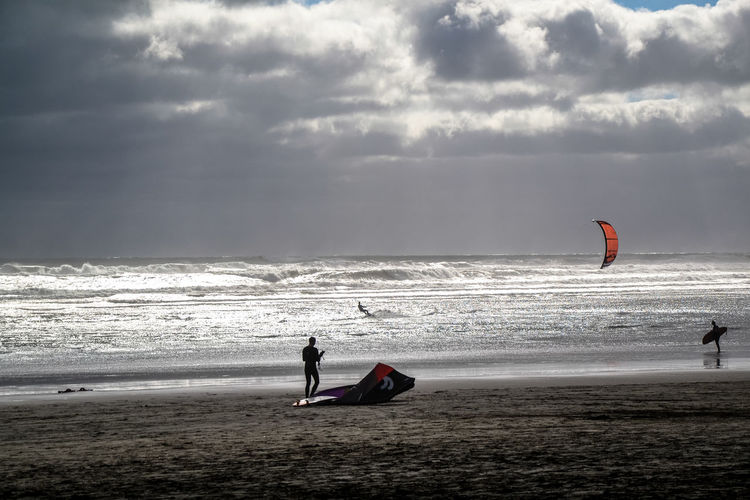 Kitsurfing Adventure Aquatic Sport Beach Beauty In Nature Cloud - Sky Extreme Sports Horizon Horizon Over Water Kiteboarding Kitsurf Land Leisure Activity Nature Outdoors People Real People Scenics - Nature Sea Sky Sport Water Watersports Wave