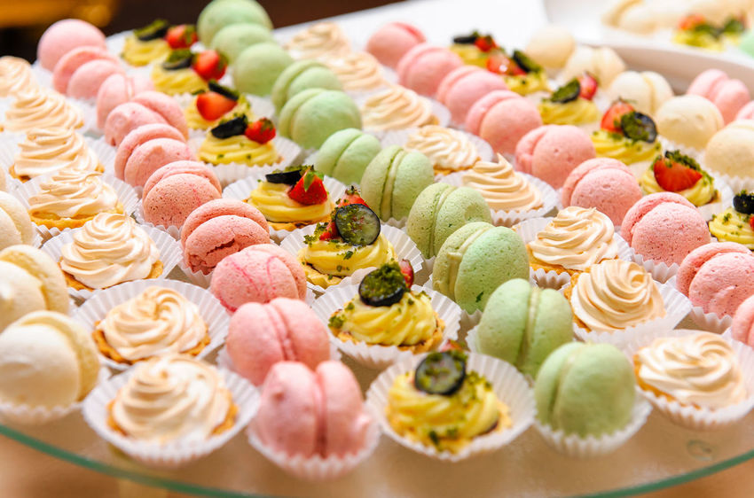 Tray with delicious cakes and macaroon Banquet Macaroons Appetizers Assortment Banquet Hall Banquet Table Cake Candy Celebration Event Close-up Cupcake Dessert Food Food And Drink Freshness In A Row Indoors  Indulgence No People Nobody Ready-to-eat Row Sweet Food Temptation Variation