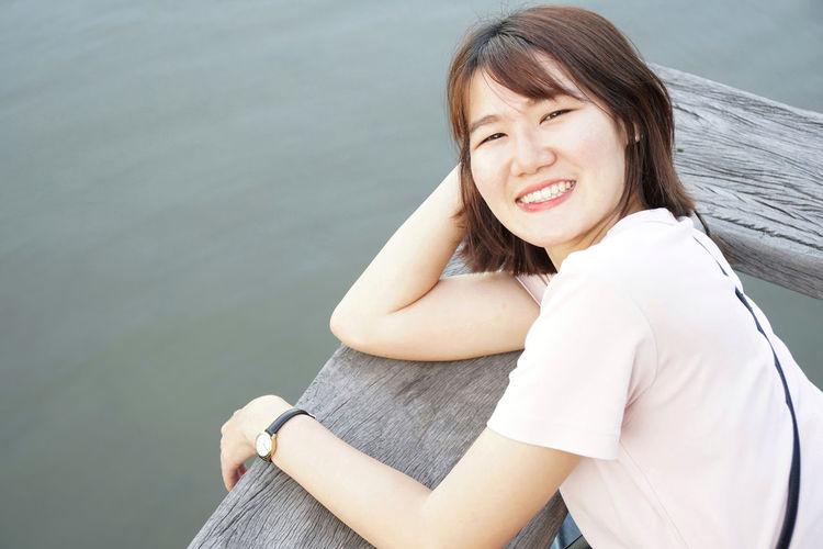 Beautiful young woman sitting in water