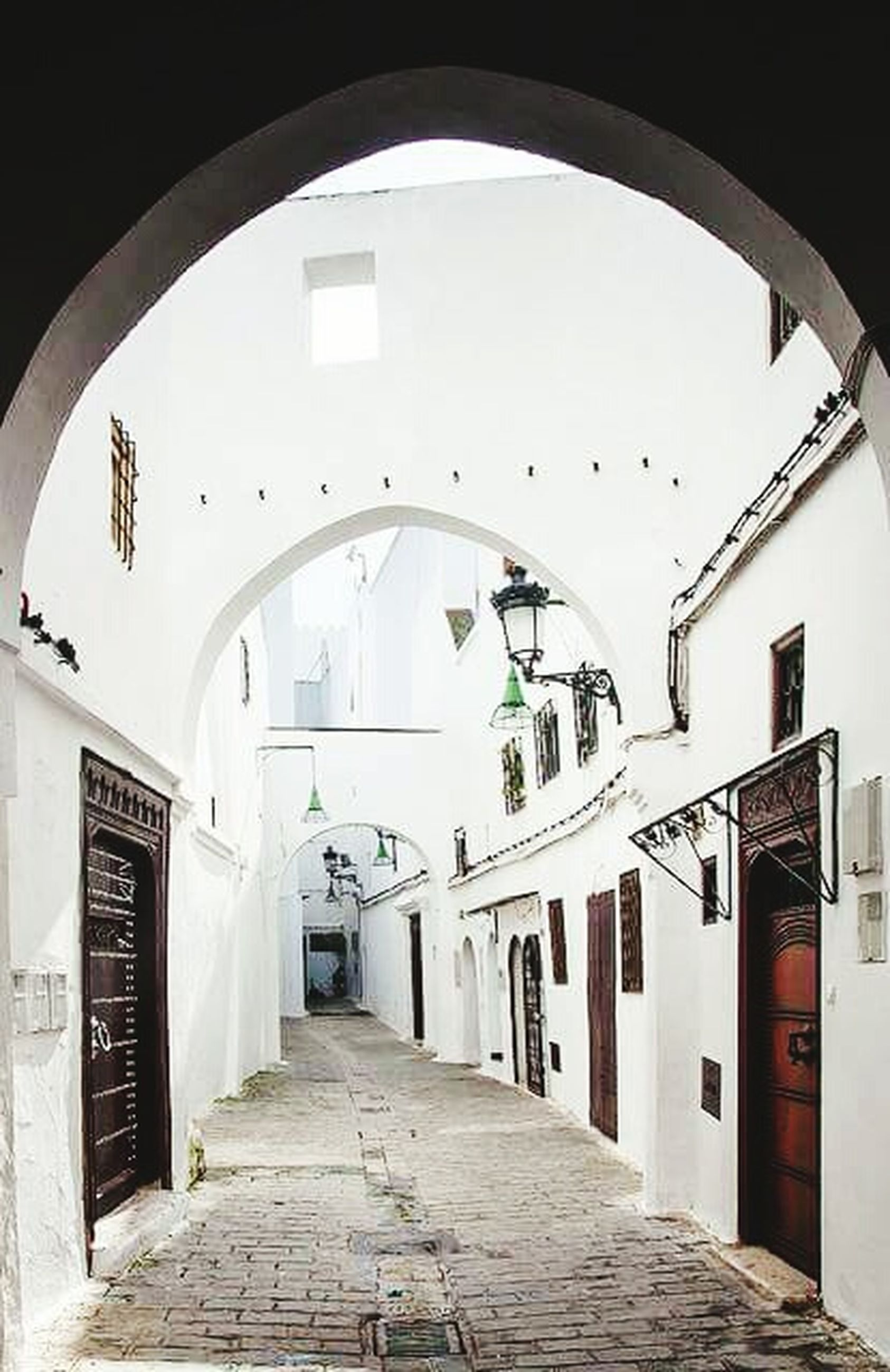 architecture, built structure, the way forward, arch, building exterior, narrow, archway, diminishing perspective, alley, empty, building, indoors, entrance, door, residential structure, vanishing point, corridor, walkway, cobblestone, day