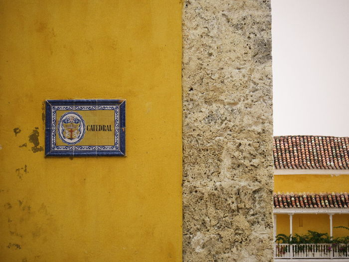 Cartagena Colombia Yellow Yellow Wall Catedral Street Sign Cartagena, Colombia Color Palette
