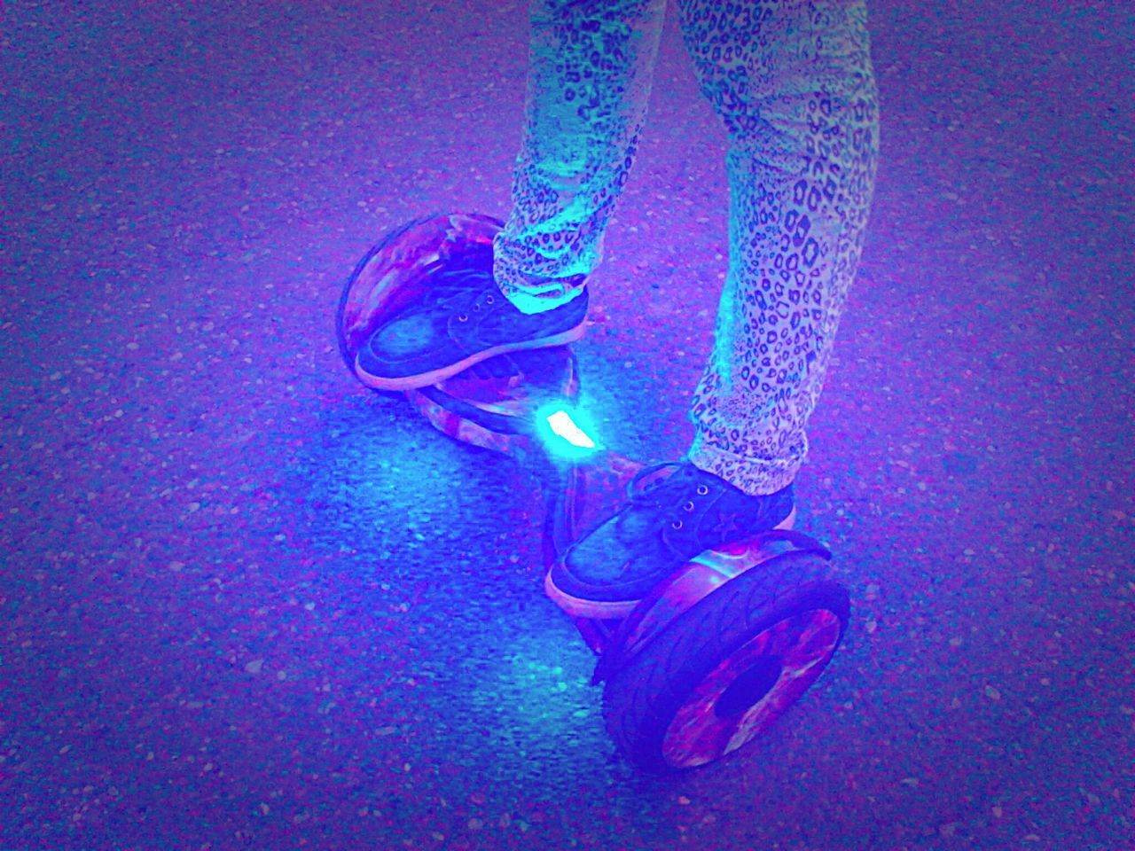 low section, human leg, one person, blue, shoe, human body part, illuminated, real people, indoors, close-up, day, people