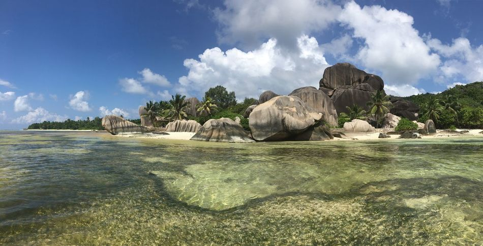 Beach Beauty In Nature Cliff Cloud Cloud - Sky Day Geology Idyllic Mountain Non-urban Scene Remote Rock - Object Rock Formation Seychelles Sky Tranquil Scene Tranquility Water