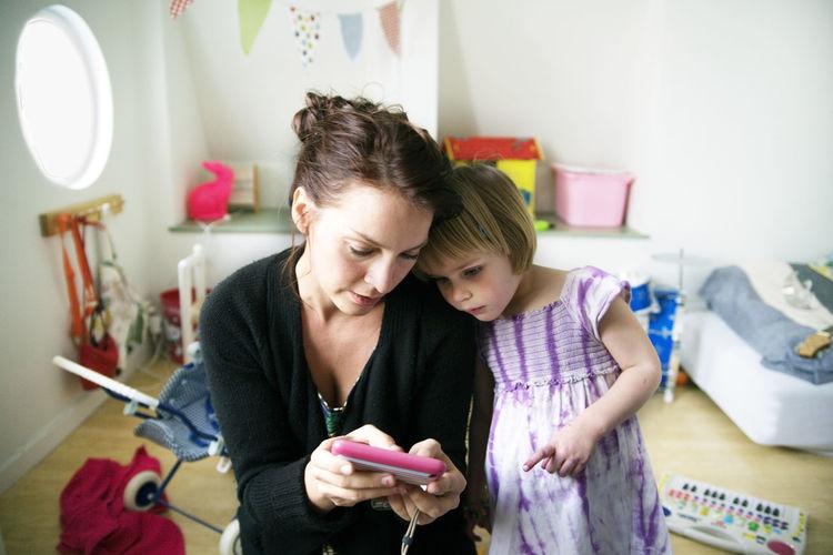 Portrait of happy girl using mobile phone