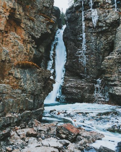 Beauty In Nature Cliff Day Glacial Nature No People Outdoors Rock - Object Rock Formation Scenics Snow Water Waterfall Winter