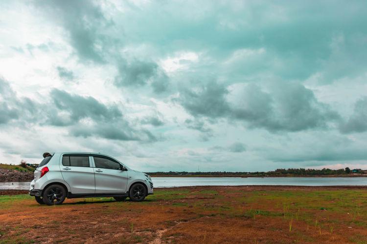 Car on land against cloudy sky