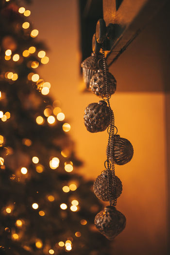 Close-up of illuminated christmas lights hanging from tree