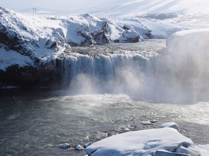 Scenic view of godafoss waterfall during winter