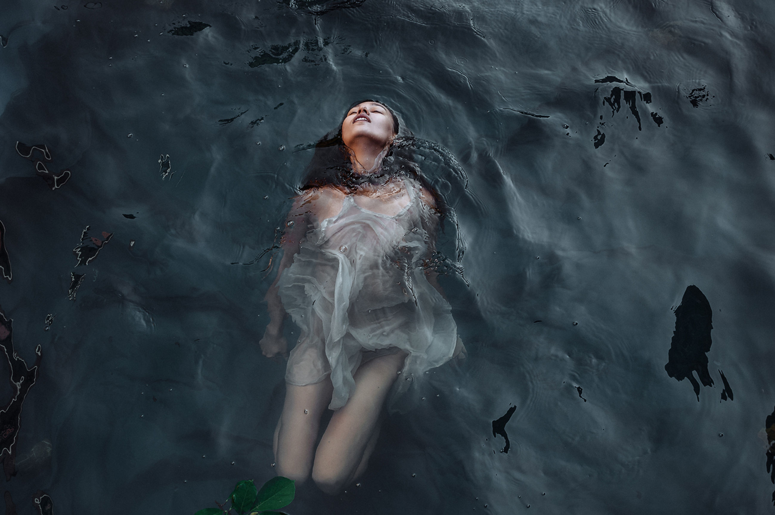 YOUNG WOMAN IN WATER AT PARK