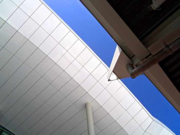 Flying wing roof and pillar Angles And Lines Architectural Detail Architectural Details Architecture Building Exterior Built Structure Clean Look Clear Sky Close-up Day Indoors  Looking Up Low Angle View Modern Modern Architecture No People Pattern Pillar Roof Sky Squares And Lines Squares And Rectangles White Building Window