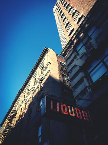 NYC Street Photography NYC Bar Bar Scene Bar Sign Neon Neon Sign Red Neon Low Angle View Scenery Clear Sky No People Art Is Everywhere Close-up Sky Blue Sky Built Structure Nyc Architecture Nyc Buildings Low Angle