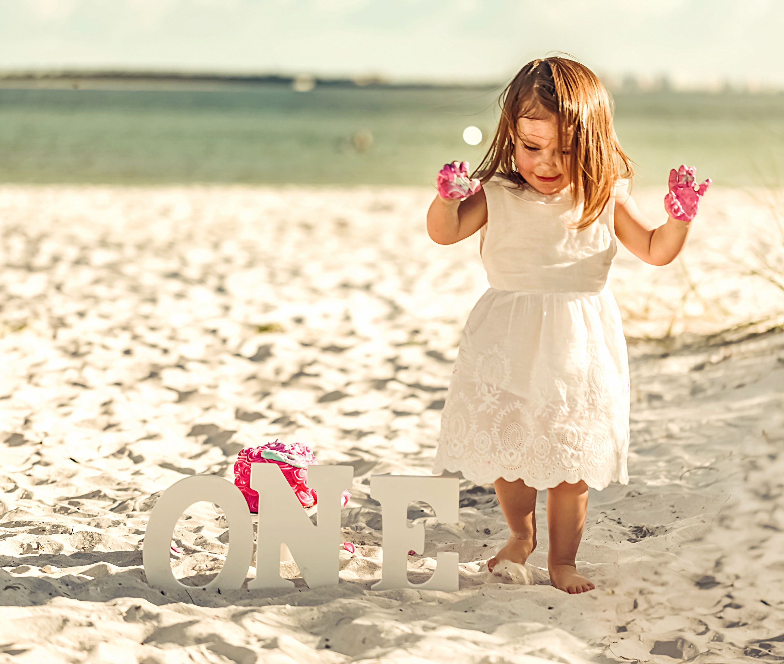 land, beach, child, childhood, one person, nature, leisure activity, real people, beauty in nature, girls, sunlight, full length, standing, women, lifestyles, flower, sea, hairstyle, innocence, outdoors